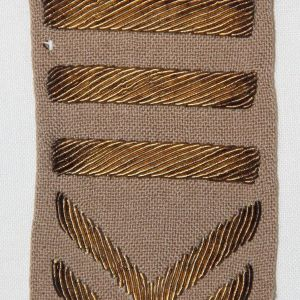 G125. THREE WWI AND FIVE WWII BULLION OVERSEAS STRIPES
