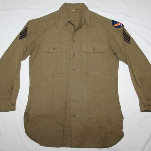 D073. WWII MUSTARD COLOR WOOL COMBAT FIELD SHIRT WITH AAF PATCH
