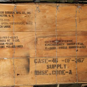 T183. CRATE OF 50 VIETNAM ERA CIVIL DEFENSE SURGICAL OPERATING GOWNS