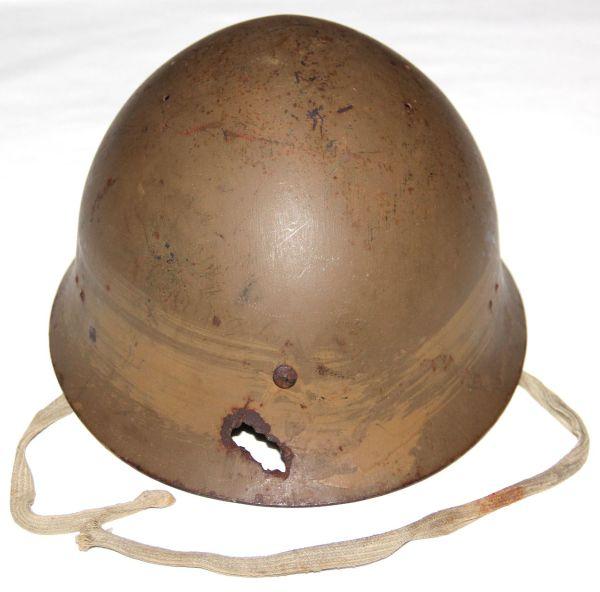 L057. WWII JAPANESE ARMY HELMET WITH SHRAPNEL DAMAGE