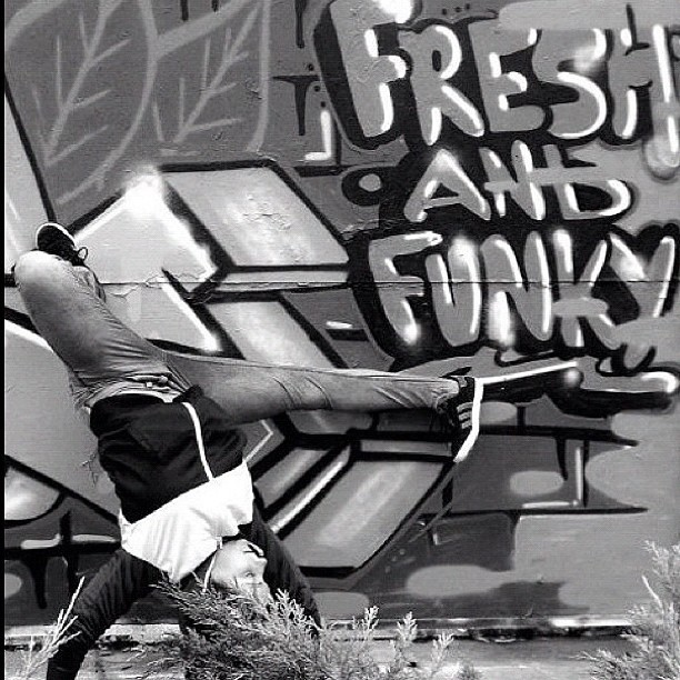 bgirl breakdancing with graffiti background