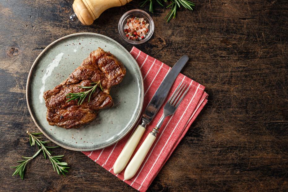 Two Beef Steak On Dark Gray Background
