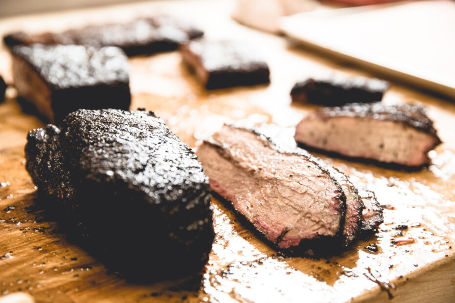 Slices Of Smoked Brisket On A Cutting Board