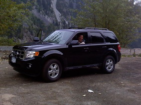 Photograph which shows the black 2012 Ford Escape the couple is believed to be travelling in;
