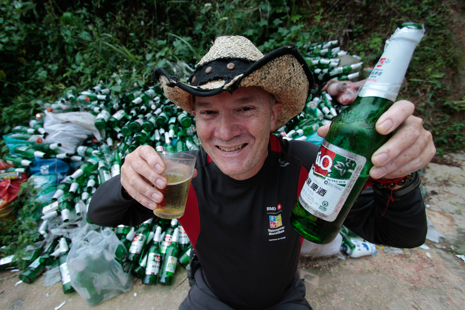 Brian with a LIQ beer after a long Rice Terraces hike (2010)