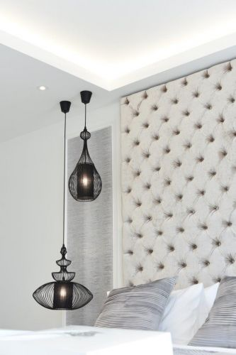 Luxury bedroom design in london with high end pendant lighting and bespoke headboard