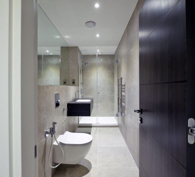 Marble clad bathroom design in Mayfair
