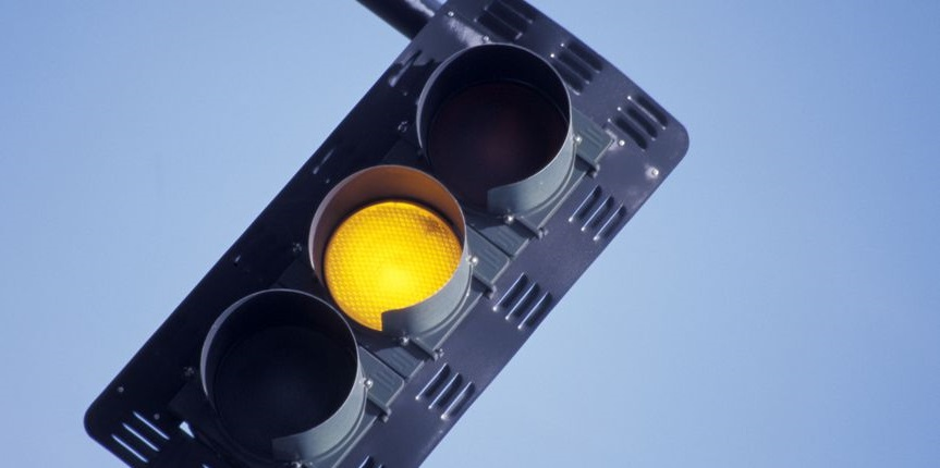 Yellow light conflicts: should I stay or should I go?