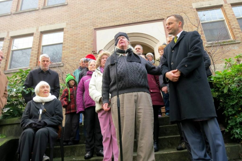Spencer Chandra Herbert (right) was accompanied by West End tenants when he announced that the province was stopping landlords from raising rents by large amounts to catch up with neighbouring buildings.