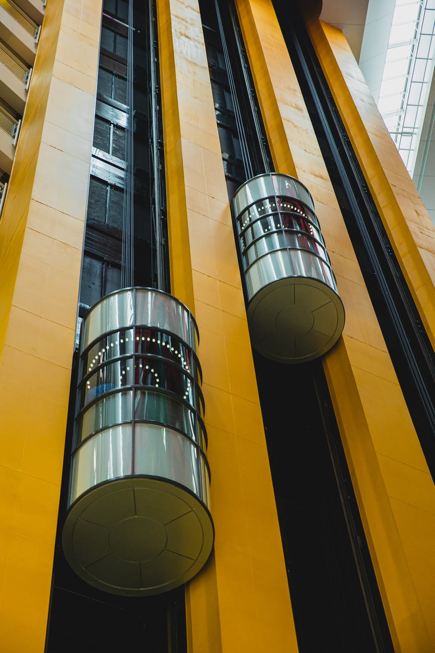 modern geometric building with moving elevators