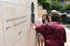 The Cullen family admires the new marker
