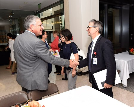 Paul Klotman greets Dr. Howard Weiner, professor of neurosurgery.