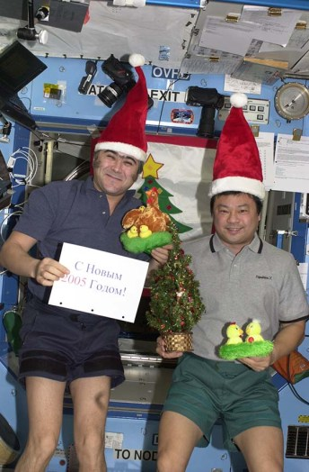 Dr. Leroy Chiao, right, and a colleague aboard the space shuttle at the holidays.