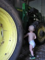 That's a big tractor tire and a small boy.