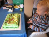 Blowing out two big candles on his cake his MeMe made him.