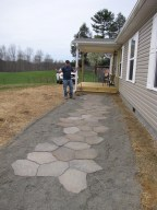 My husband and his perfected walkway. He's worked hard!