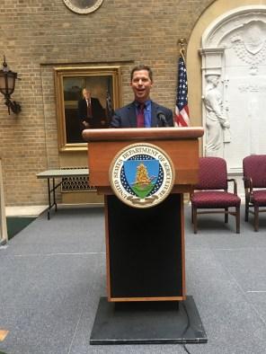 Chris pretending to be the President's Press Secretary