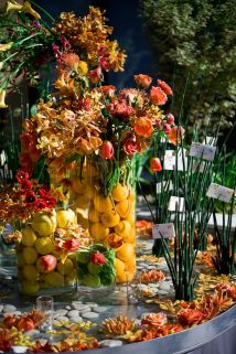 Fruit filled floral vases by Event Planner Waterlily Pond - Photo by Cliff Brunk