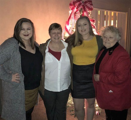 four women posing for picture