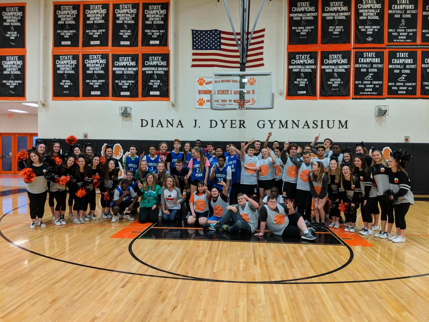 Unified basketball team and cheerleader after a game.