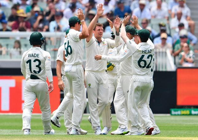Australian paceman James Pattinson (C) celebrates after dismissing New Zealand batsman Mitchell Santner on the third day of the second cricket Test match at the MCG in Melbourne on 28 December 2019. Photo: AFP