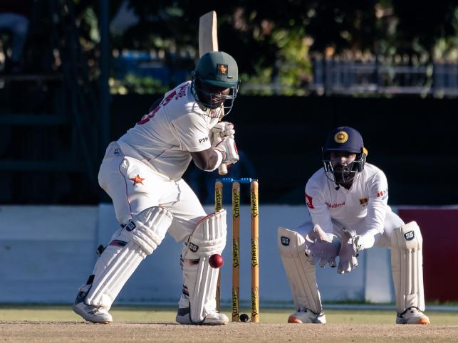 Zimbabwe`s batsman Prince Masvaure (L) prepares to hit the ball past wicket keeper Niroshan Dickwella looks on during the fourth day of the first Test cricket match played between Zimbabwe and Sri Lanka at the Harare Sports Club in Harare on 22 January, 2020. Photo: AFP
