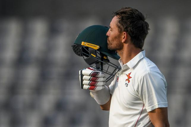 Zimbabwe`s captain Craig Ervine reacts after scoring a century (100 runs) during the first day of the first Test cricket match between Bangladesh and Zimbabwe at the Sher-e-Bangla National Cricket Stadium in Dhaka on 22 February, 2020. Photo: AFP