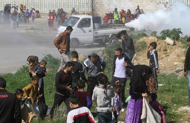 Image of Syrian refugees during fumigation