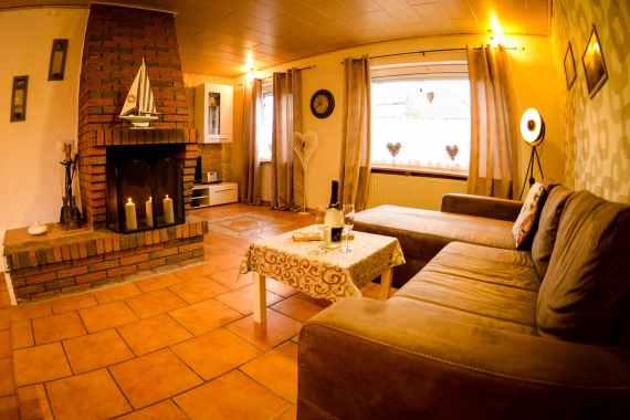 Wohnzimmer mit Kamin im SM Ferienhaus