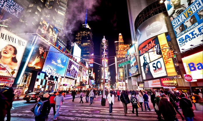 Illuminated Times Square at evening - is the most popular tourist spot