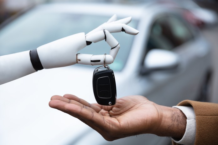 Robot Giving Car Key To Man