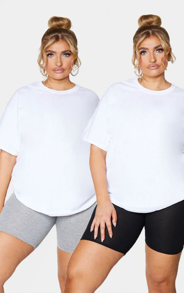 Two plus-size models wearing bike shorts.