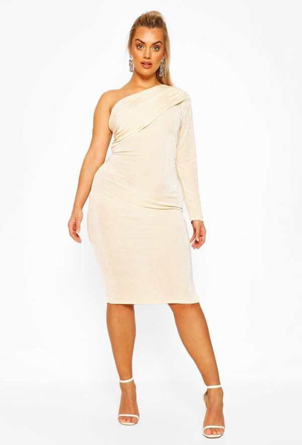 Woman wearing a white cocktail dress.