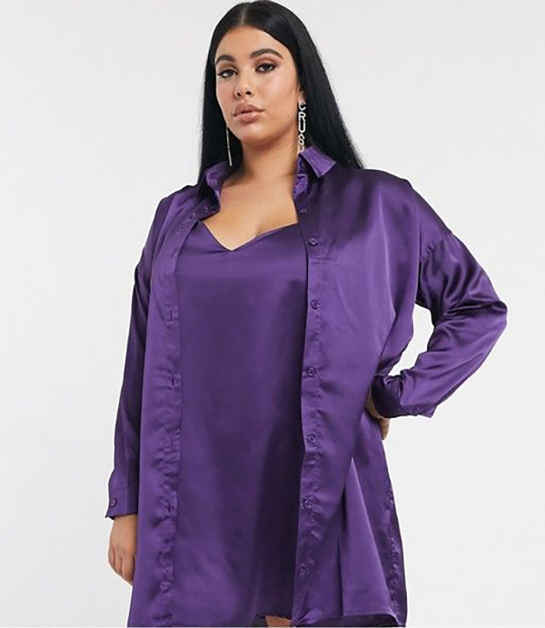 A plus-size model wearing a purple satin matching set.