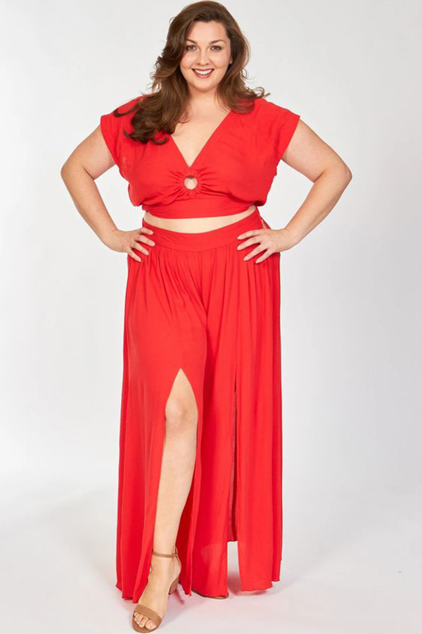 A plus-size model wearing a red matching set.