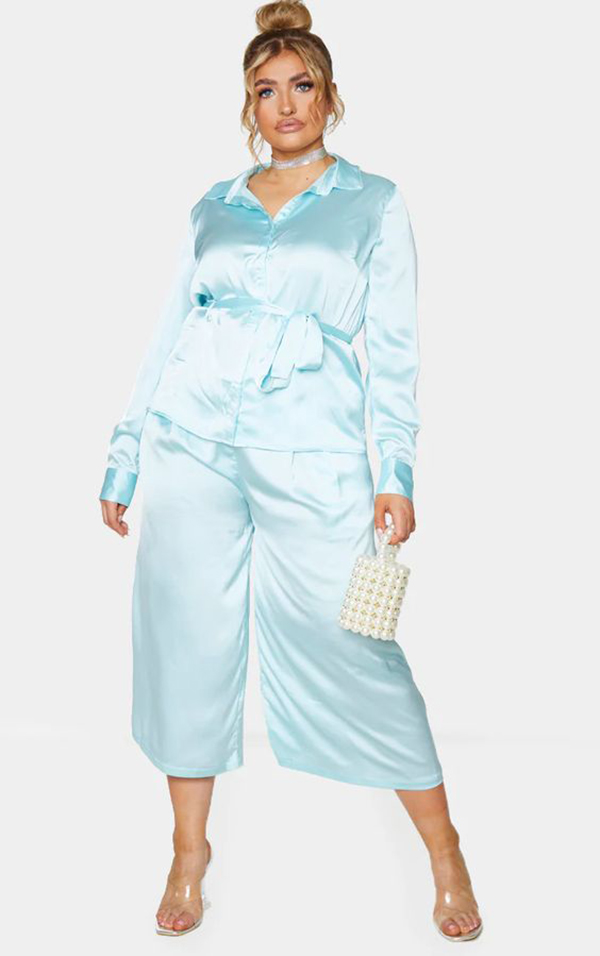 A plus-size model wearing a light blue matching set.