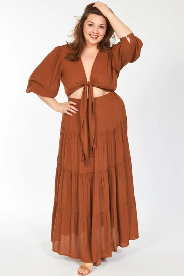 A plus-size model wearing a brown matching set.