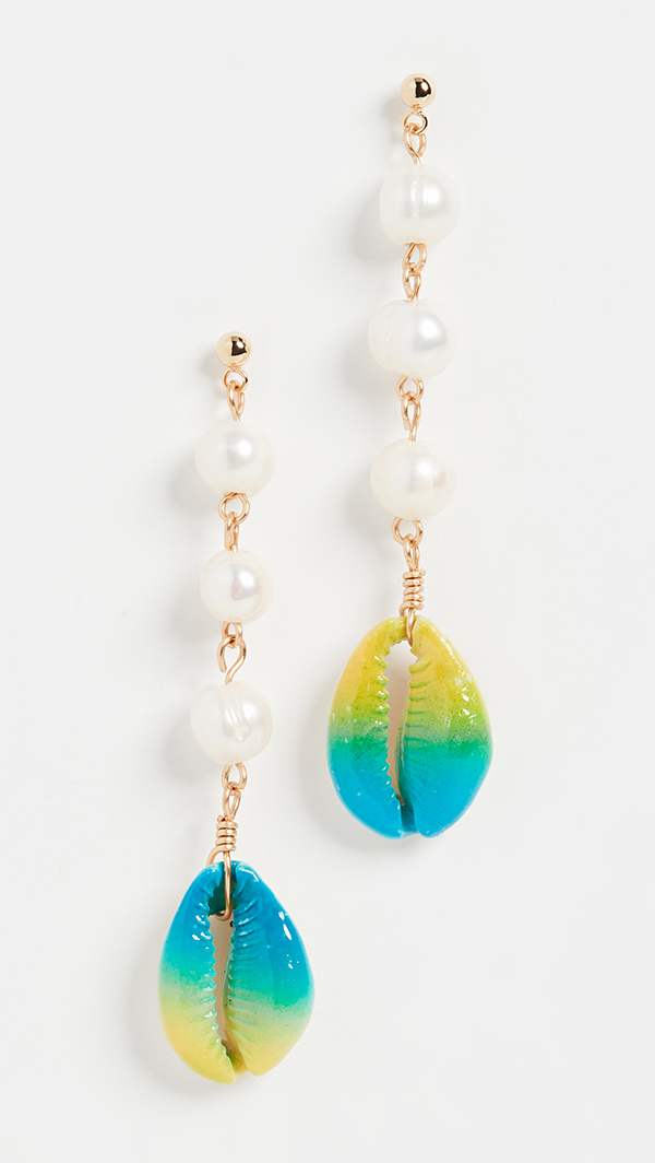 A pair of drop earrings lined with pearls and painted cowrie shells.
