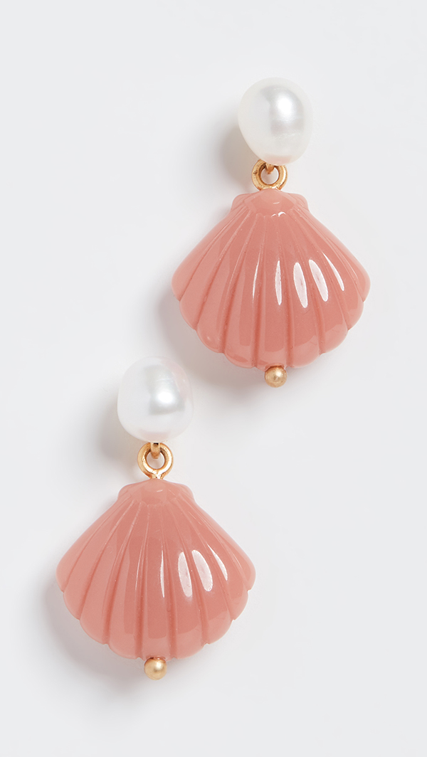 A pair of plastic earrings molded to look like scallop shells.
