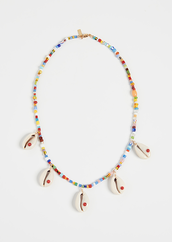 A rainbow beaded necklace with cowrie shells on it.