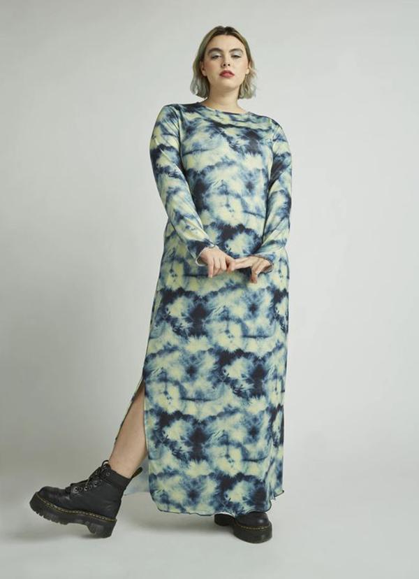 A plus-size model wearing a teal tie-dye maxi dress.