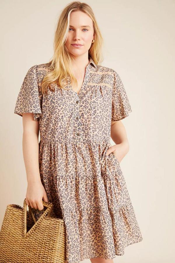 A plus-size model wearing an animal print shirtdress.