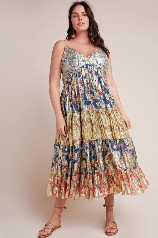 A plus-size model wearing a metallic patchwork dress.