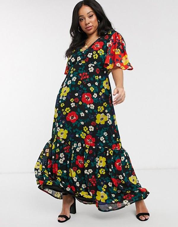 A plus-size model wearing a floral patchwork dress.
