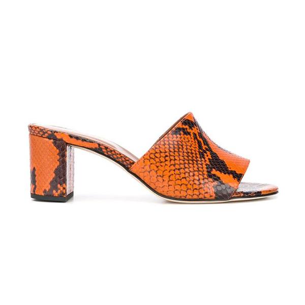A neon orange snakeskin slip-on heel.