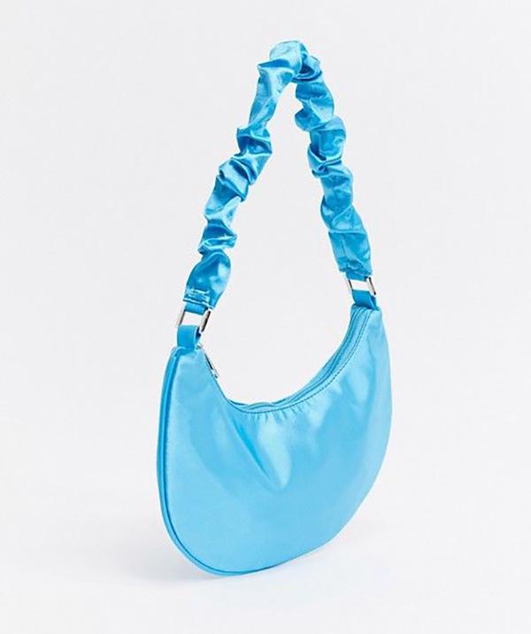 A neon blue satin handbag.