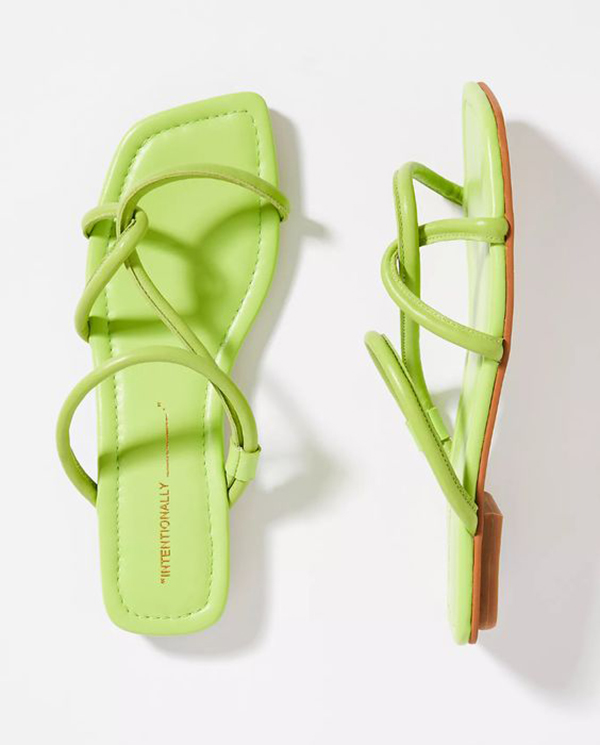A pair of neon green sandals.