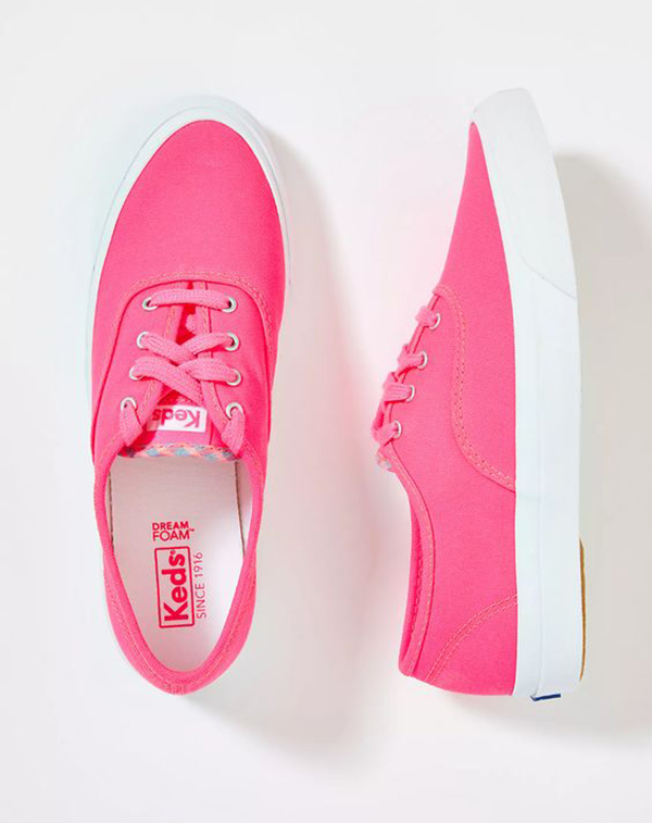 A pair of neon pink sneakers.