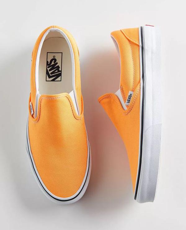A pair of neon orange sneakers.