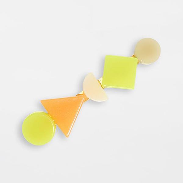 A neon yellow-green and orange barrette.